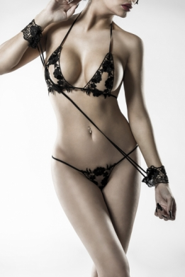 This kinky bra set consists of bra, thong, wristbands, mask Erotic bra and matching thong are made from detailed lace.
